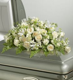 White Rememberence Casket Spray ~ I love the roses but you can save money by using carnations! Condolence Flowers, Sympathy Flowers, Funeral Bouquet, Funeral Flowers, Funeral Floral Arrangements, Flower Arrangements, Casket Flowers, Funeral Caskets, White Carnation