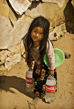 Carrying water for her family.