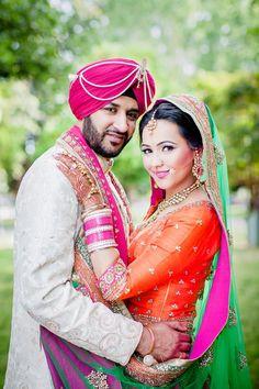 Punjabi bride and groom in pink and orange