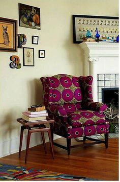 UPHOLSTERING AFRICAN FABRIC TO A CHAIR ADDS A SPLASH OF COLOR TO A ROOM.