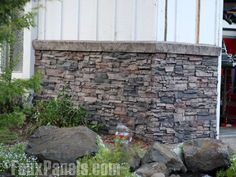 Stone Veneer Panels and Siding to cover up the textured cement where the basement begins