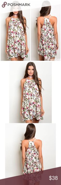 New! Racerback Ivory Floral Trapeze Dress New! Racerback Ivory Floral Trapeze Dress. Fabric: 97% polyester 3% spandex. Made is USA. No Trades. Price is Firm Unless Bundled. GlamVault Dresses
