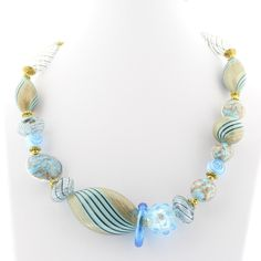 Handblown Italian Venetian Murano Glass bead necklace with teal beads embellished with gold metallic and black stripes. - Materials: Hand-blown Venetian Murano glass beads, Teal Beads and gold-tone fi