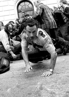 Badass shot of Rick Grimes narrowly escaping some walkers in season 1