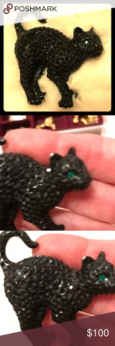 Black cat brooch Vintage Swarovski black cat with green eyes. There is a small spot on the ear missing enamel. Swarovski Jewelry Brooches