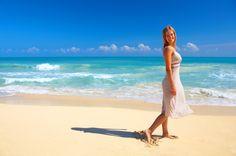Hot girl on a beach waking.