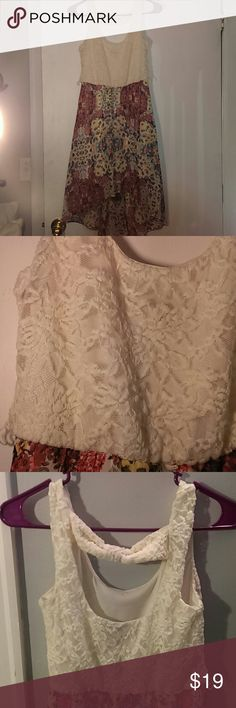 Semi Backless Junior High-Low Floral Dress w/ Lace Worn twice. Smooth polyester. No snags, stains, smells, holes. Cream lace on torso, colorful floral on bottom half. High-low from front top knees to back below knees. Backless with subtle bow across. Can be worn with a thin belt as it has loops. Inside lining for the dress under florals. Lily Rose Dresses