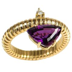 handmade flexible18kt yellow gold ring set with amethyst and diamond