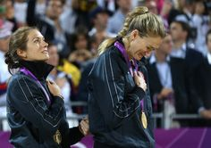 I love this picture of Misty and Kerri. Hands clasped, listening to the national anthem for the last time as a team. It really shows the kind of team they were and what they mean to each other. <3