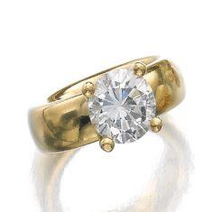DIAMOND RING, BUCHERER.  Claw-set with a brilliant-cut diamond weighing 3.01 carats, maker's mark for Bucherer.