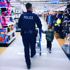 A COP AND HIS LITTLE BUDDY. This is a photo I took of an Officer/Partner of mine during Shop With A Cop with his little buddy. This picture describes what I think is the truth behind our profession. Hope you enjoy this photo as much as I do. - Officer Rivera, Roselle Police Department, IL Thanks for the picture Jay  Law Enforcement Today www.lawenforcementtoday.com
