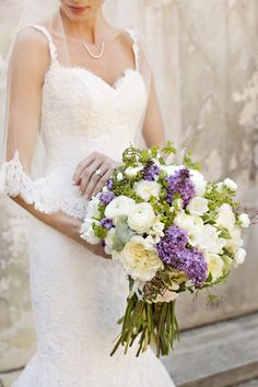 Fresh spring lilac, ranunculus, and garden rose bouquet | Photography: Brooke Beasley Photography - brookebeasleyphotography.com  Read More: http://www.stylemepretty.com/california-weddings/2015/06/02/english-countryside-wedding-inspiration/