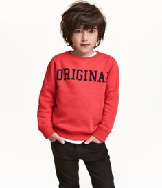 Red. Soft sweatshirt with a printed design at front and ribbing at neckline, cuffs, and hem. Soft, brushed inside.