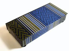Decorative box , tapestry-like repeating design paper in blue, black and gold, for display or storage of  treasures or necessities