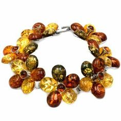 Sterling Silver Multicolor Amber Bracelet Length 6.5 Inches GRACIANA. $214.98. All amber jewelry designs are from Eastern Europe. Save 52%!