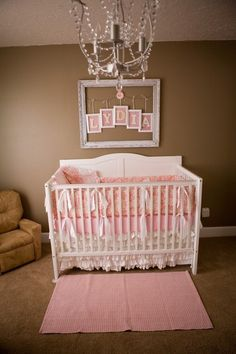 I like the frame and baby name on the wall above crib.