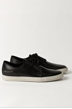 have a pair of these Common Projects Rec Leather Black Sneakers, in white. I swear now they kinda look yellowish...