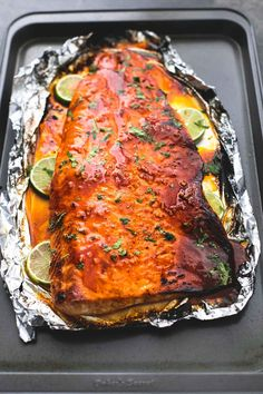 Sweet and spicy, baked honey sriracha lime salmon in foil is tender and flaky and has the most incredible flavors. A healthy and easy 30 minute meal for salmon lovers. Baked Salmon Recipes, Fish Recipes, Seafood Recipes, Dinner Recipes, Cooking Recipes, Healthy Recipes, Macro Recipes, Yummy Recipes, Recipies