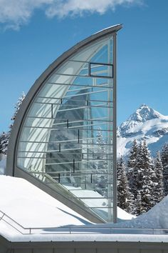 Modern Wellness Center: Berg Oase, located in Arosa, Switzerland | A project by: Mario Botta Architetto featuring modern glass architecture beautiful set within the mountains.