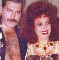 """Freddie Mercury at Fashion Aid, together with Arlene Phillips, very famous coreographer, who worked with Freddie during the shooting of the """"I Was Born To Love You"""" video. Royal Albert Hall, London, November 5th 1985."""
