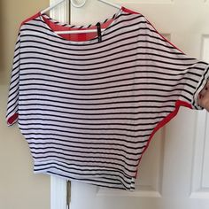 Love culture black & white striped top Love culture black & white striped top with red sheer back with black and gold buttons. Size small. Brand new no flaws. Wore couple of times. But like new. Size small Love Culture Tops
