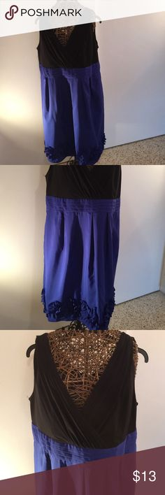Royal blue and black sleeveless dress Black vee neck and back top portion with Royal blue taffeta banded waist band and skirting. Empire waist, pleated skirting and ruffles at hemline. Perfect for a daywear tonight wear! Dresses
