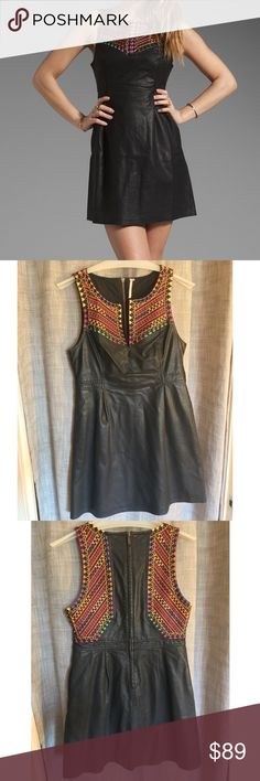 Free People Vegan Leather Multi Embroidered Dress EUC. True to size. Strong pockets that don't make the dress sag. 6 large clips up front so you can wear it open or closed. High quality zipper down the back. Very cute, too large for me now. Smoke free home. Free People Dresses Mini