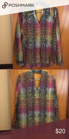 Colorful blouse Multicolored snakeskin patterned blouse. Has a keyhole cutout in the back. Slightly longer in the back. The material is 100% polyester and sheer, although it doesn't seem sheer due to the pattern and color. Lightweight and wonderful! Deb Tops Blouses