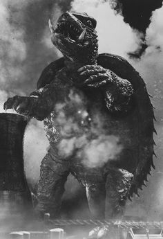 Gamera, you've got to love a giant sabre-toothed, fire-breathing turtle that flies and befriends children.