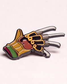 """For all the Nightmare on Elm Street fan out there I've made his iconic glove into this stunning enamel pin, hand numbered and limited to just 100 worldwide  1.25"""" x 1.75"""" approx  Made from soft enamel with a black nickel finish back and butterfly clutch"""