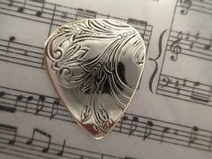 Silver and Brass Pick made by my husband.  Click on the pic!