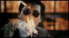 Chow Yun Fat in A Better Tomorrow.  This scene is forever etched in my mind.