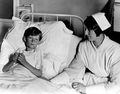 Nurse at Tacoma Hospital giving care to a young patient, circa 1920s