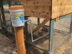 SUPREMO WATERER: Get a five gallon bucket, 8 to 10 feet of 3/4 inch pvc pipe, two elbows,  a cap and a coupler, and away you go. Set a post outside the coop. Cut three pieces of pipe as shown. Drill a 1 inch hole in the bucket. You'll need a watertight fitting to connect the pipe to the bucket. Anyone at a full service hardware store can hook you up with what you need for this.