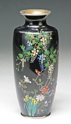 A Japanese Antique Silver Ando Cloisonne Vase: finely depicting birds perched on blooming trees, all reserved on a black ground, of 19th Century
