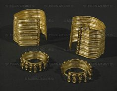 HALLSTATT CULTURE JEWELRY A pair of gold armlets and earrings from the tumulus La Butte, Sainte-Colombe, Burgundy, France Musee des Antiquites Nationales, St-Germain-en-Laye, France