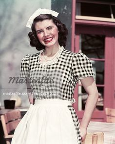 01 Jan 1950 --- smiling woman wearing black and white checked waitress outfit dress apron lace cap looking at camera Waitress Outfit, French Maid Uniform, 1950s Fashion Women, Guys And Dolls, Fashion Project, Dress Outfits, Dresses, Wearing Black, Women Wear