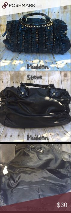 😎Madden😎 Always have always will love Steve Madden apparel. His bags are just as fun chic and elegant and his shoes. This bag is new just found while unpacking and never used it (posh life). Pristine! Buy it it's rocking! Steve Madden Bags