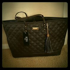 BCBG Paris Quilted Tassel Tote NWT Dark Brown BCBG Tote .  Deminsions are 20 x 5.5 x 12. MSRP is $195 Bags Totes