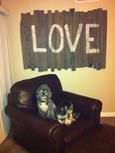 "Rustic ""Love"" sign made out of pallet wood. It was supposed to go above our bed but it ended up being to big so we put it in our bedroom wall."