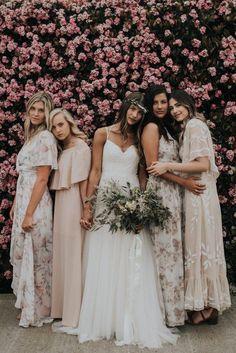 Neutral tone bridesmaid dresses with a floral flair | Image by Jonnie & Garrett