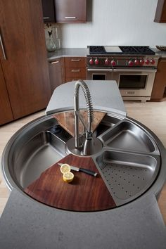 Rotating kitchen sink with cutting board, colander and more. So cool!