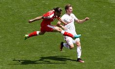 Switzerland's Ricardo Rodriguez in action with Poland's Lukasz Piszczek.