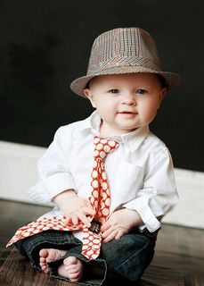 This little man is more stylin' than most grown men: fedora & polka dot tie