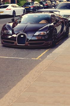 """Bugatti...{I'm not so sure I would park Mine there!! This Car Is """"A Rolling Work Of Art""""!! DREAM CAR, Y'all!!!}"""