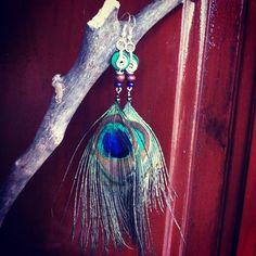 Aretes de plumas de pavo Real