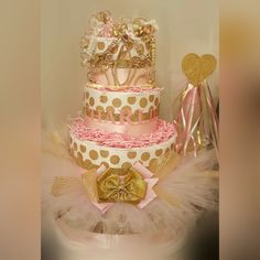 Princess Diaper Cake, Gold and Pink Diaper Cake, Princess Centerpiece, Gold and Pink Centerpiece by RibbonsandConfetti on Etsy https://www.etsy.com/listing/248784981/princess-diaper-cake-gold-and-pink