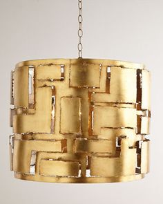 """Braxton Iron Pendant Light  Edgy and rugged, this striking pendant light makes a strong statement as it brings light to the room. Its gold-leaf finish adds a bit of polish. Handcrafted of iron. Gold-leaf finish. Interior three-light candle cluster; uses three 40-watt bulbs. Antiqued-brass canopy included. Direct wire; professional installation required. 26""""Dia. x 20""""T with 3'L chain. Imported. Boxed weight, approximately 37 lbs."""