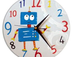 This fun clock is hand-painted and features a friendly robot The clock is made from a high quality wood and contains a Quartz mechanism. The clock requires one AA batteries. Clock measures approximately 23 cm / 9 inchesThe clock is also available in a . Wall Clock Nursery, Robot Nursery, Nursery Decor Boy, Nursery Ideas, Bedroom Ideas, Small Clock, Clock For Kids, Robots For Kids, Picture On Wood