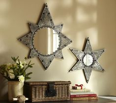 """Pottery Barn.  Stamped Metal Clad Star Mirror.  Large: 27.5""""D, Small: 20""""D."""